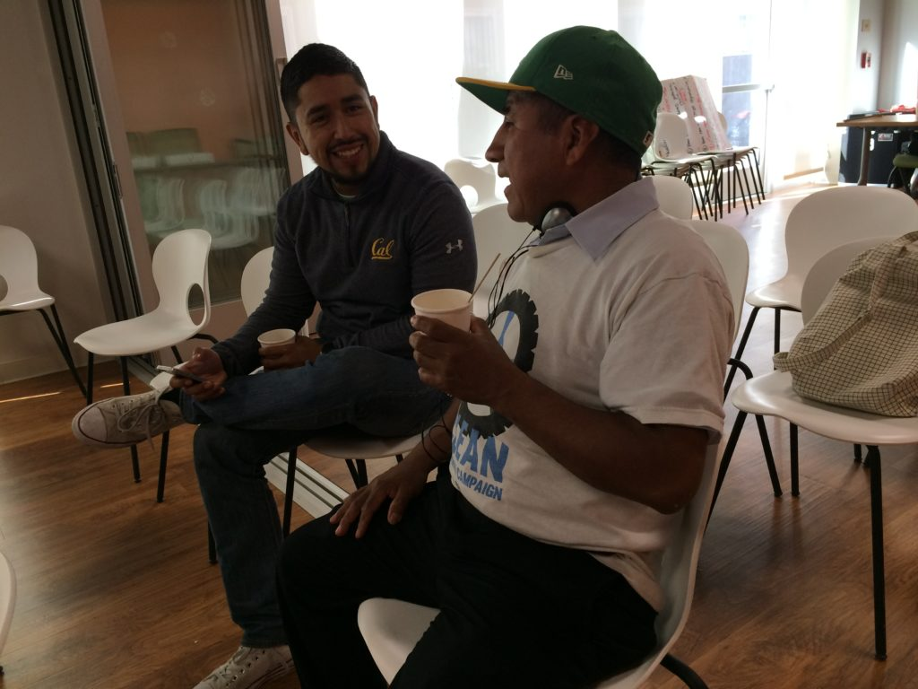 Fausto of the CLEAN Carwash Campaign chats with Hugo from KIWA